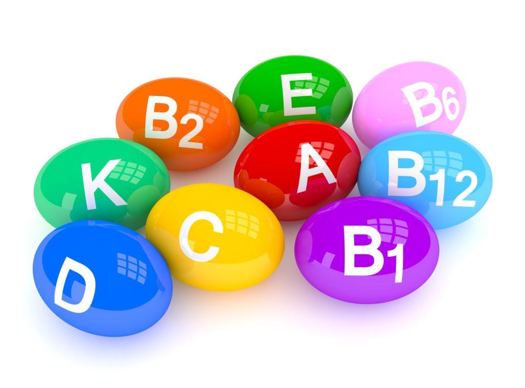 цветные овальные бусины с буквенным обозначением витаминов